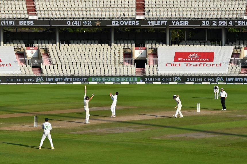 England's Chris Woakes (second from left) celebrates after hitting the winning runs during a Test cricket match against Pakistan at Old Trafford in Manchester on Aug 8, 2020.
