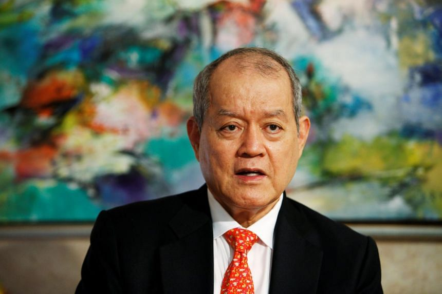 Mr Lim Oon Kuin, also known as O.K. Lim, with his son Evan Lim Chee Meng and daughter Lim Huey Ching, owns 77 companies under the Xihe Group.