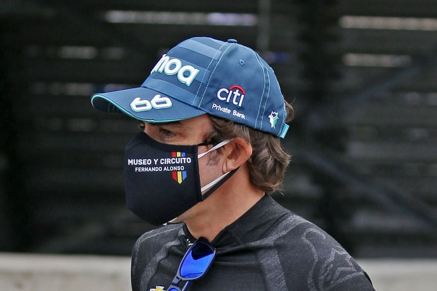 Alonso walks through the pits during practice for the 104th running of the Indianapolis 500 on Aug 12, 2020.