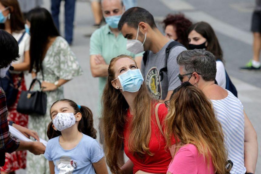 People walk in protective masks in Pontevedra, Spain, Aug 13, 2020.