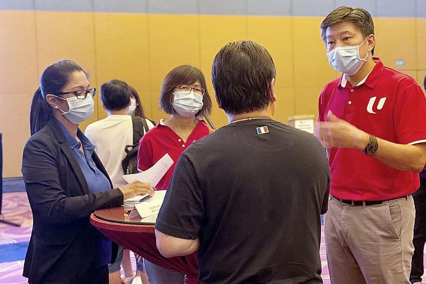 NTUC secretary-general Ng Chee Meng (right) visiting Resorts World Sentosa staff amid a retrenchment exercise last month. In an interview on Thursday, Mr Ng noted that the overall level of anxiety among Singaporeans over foreigners working here has h