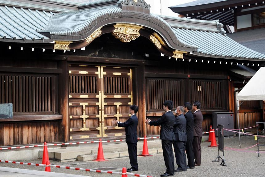 Visitors pay tribute at the Yasukuni shrine in Tokyo on Aug 15, 2020.