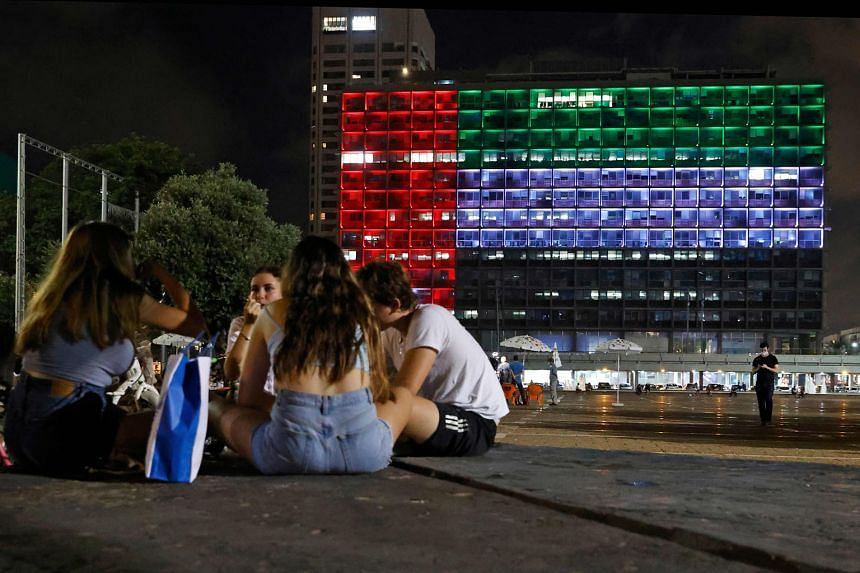 ISRAEL The Tel Aviv City Hall on Thursday, lit up in the colours of the United Arab Emirates flag, after Israel and the UAE reached a deal to normalise diplomatic relations between the two states. US President Donald Trump helped to broker the agreement.