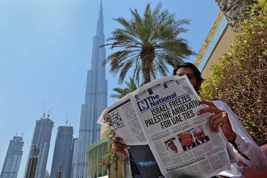 DUBAI A man reading the United Arab Emirates-based newspaper The National in Dubai yesterday, with a report on its front page on what the UAE describes as an agreement that will stop further Israeli annexation of Palestinian territories.