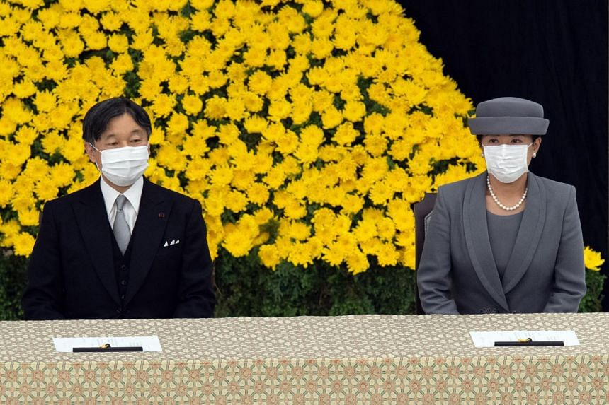 Japan's Emperor Naruhito (left) and Empress Masako attend a memorial service at the Nippon Budokan hall in Tokyo, on Aug 15, 2020.
