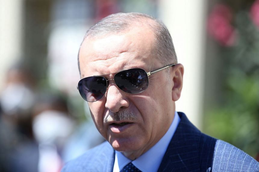 Erdogan talks to the media after attending Friday prayers at a mosque in Istanbul, Aug 14, 2020.