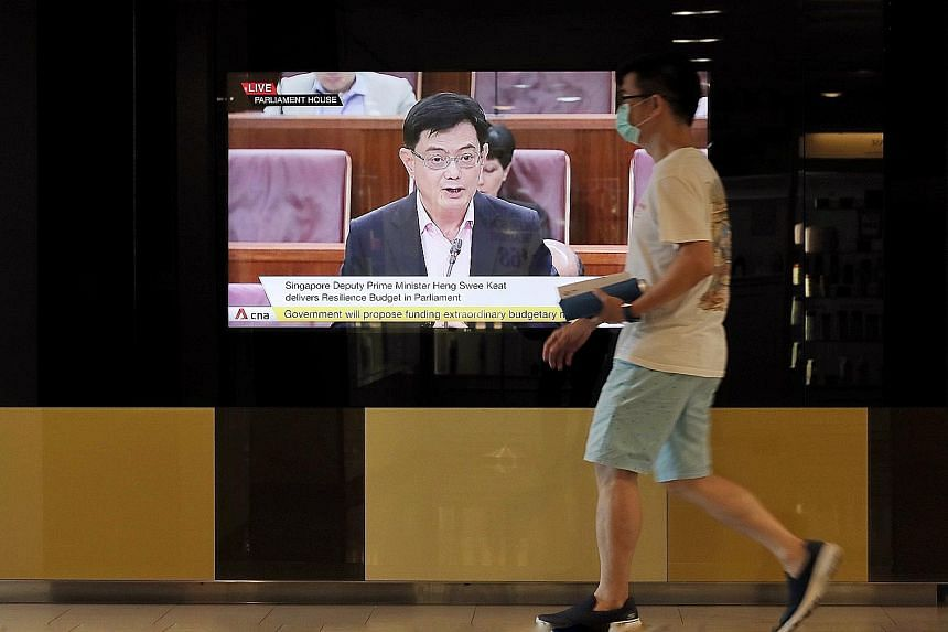 Deputy Prime Minister Heng Swee Keat seen on television announcing the Resilience Budget on March 26. This year's four Budgets together commit close to $100 billion - or nearly 20 per cent of gross domestic product - in Covid-19 support measures. Som