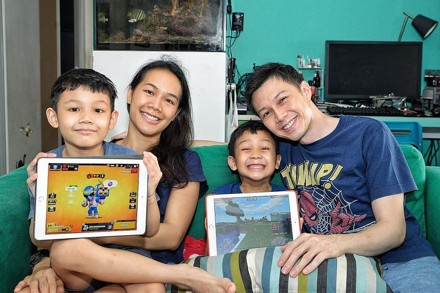 Mr Leonard Ng (with Mrs Alicia Ng and sons Kaleb, left, and Oliver) was not bothered about his kids' screen time because he knew they would resume outdoor activities after the circuit breaker.