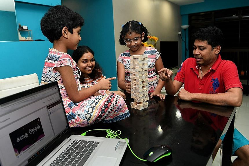 Mr Sankar Subramanian and his wife, Ms Durga Devi Gopala Pillai, used games like Jenga to lure their children Vania and Akshara away from screens.