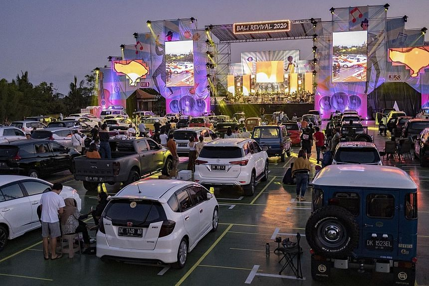 People at a drive-in concert in Ubud, Bali, yesterday. The Indonesian holiday island reopened to domestic tourists on July 31 and the government is considering allowing foreign visitors to enter again.