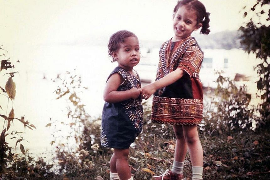 Kamala Harris (right) with her sister Maya in dashikis - a garment worn mostly in West Africa - in a photo from their childhood.