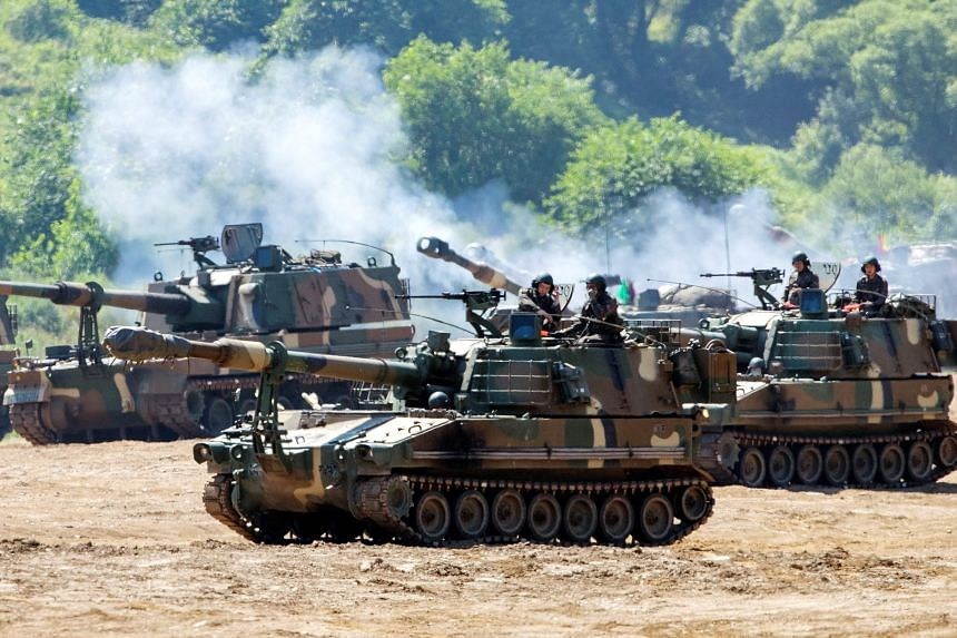 South Korean Army's K-55 self-propelled howitzers move at a military training field in the border city of Paju, on June 22, 2020.