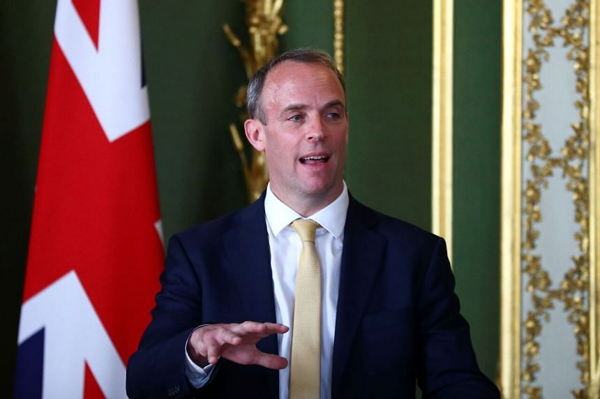 Britain's Foreign Secretary Dominic Raab during a meeting at Lancaster House in London on July 21, 2020.