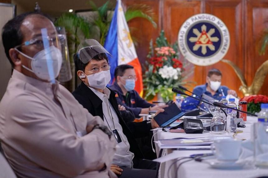 Philippine Interior Secretary Eduardo Ano (second from left) was first diagnosed with Covid-19 in March.