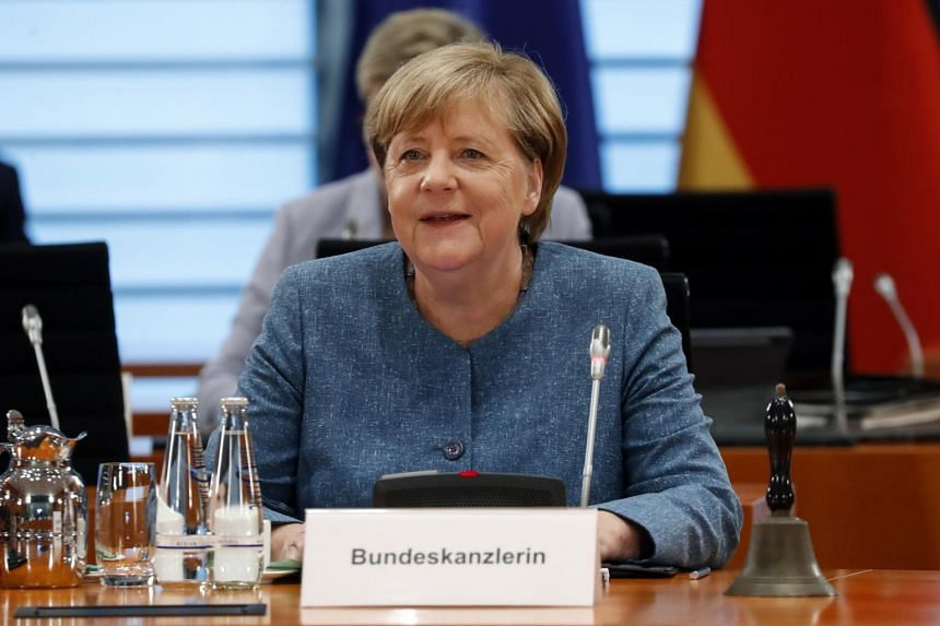 German Chancellor Angela Merkel smiles during a cabinet meeting at the German chancellery in Berlin on Aug 12, 2020.