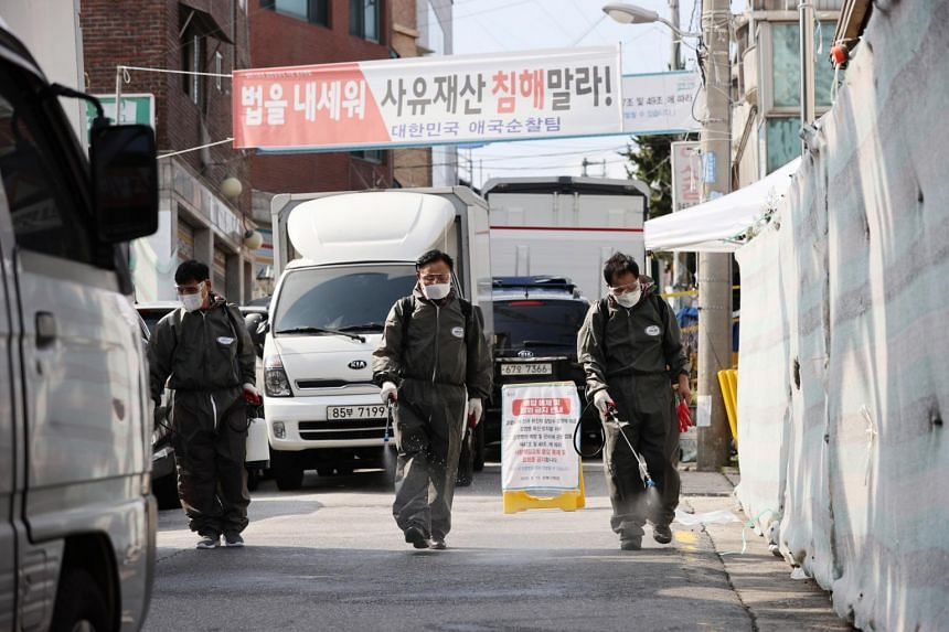 Health officials disinfect streets around Sarang Jeil Church in Seoul on Aug 17, 2020.