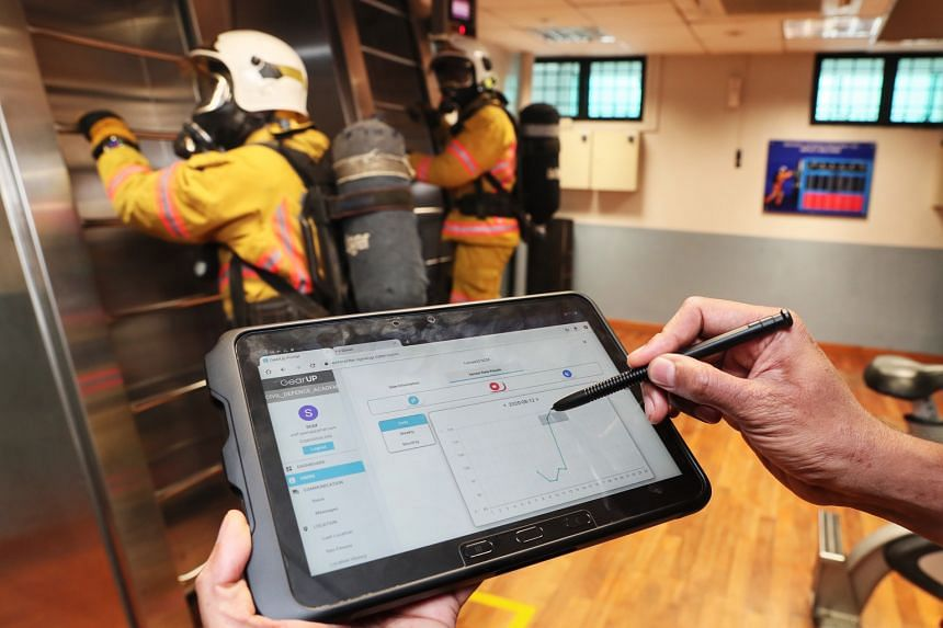 A tablet being used by Singapore Civil Defence Force instructors to monitor the vital signs of cadets during training. Instructors will be able to gauge if any cadet is over-or under-exerting himself by looking at his heart rate, recorded by the smar