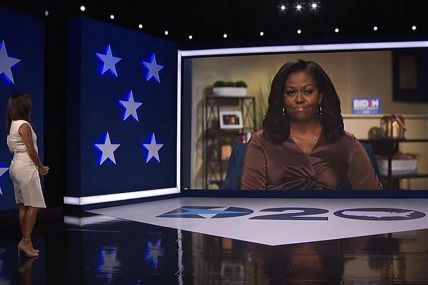 Former first lady Michelle Obama, who was introduced by host Eva Longoria, on screen during the Democratic National Convention that was broadcast from Milwaukee, Wisconsin, on Monday. Mrs Obama said Mr Joe Biden's steady and empathetic approach to pr
