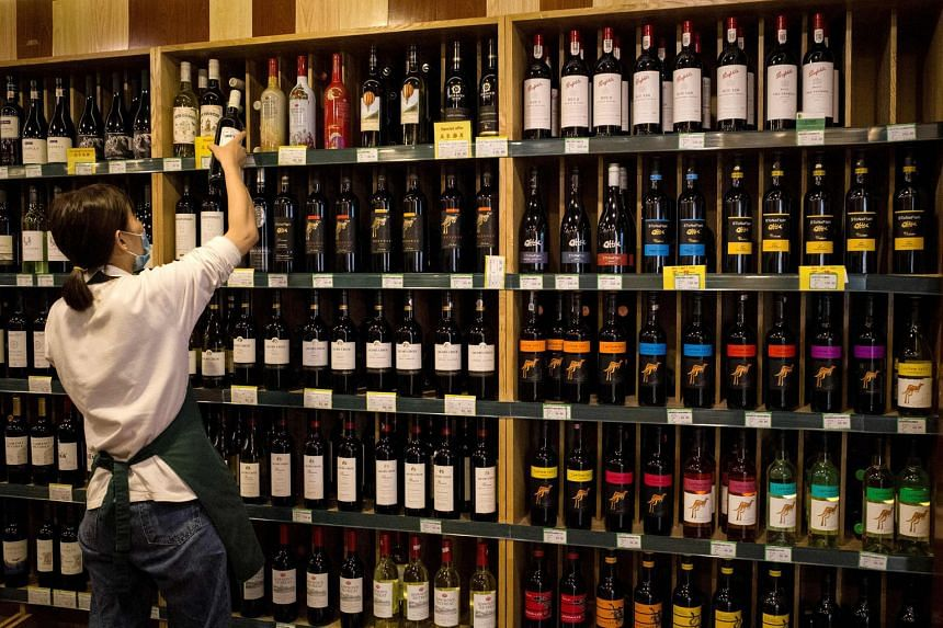 Australian wine seen among others in a Beijing store. The latest anti-dumping probe will likely worsen tensions with Australia. PHOTO: AGENCE FRANCE-PRESSE
