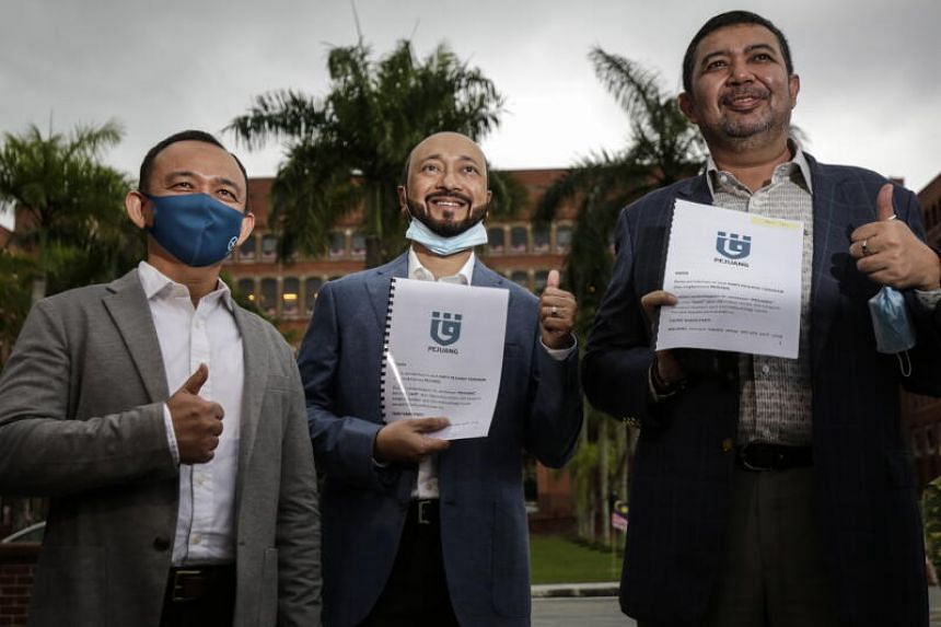 Mukhriz Mahathir (centre) with the new party Pejuang's application in Putrajaya on Aug 19, 2020.