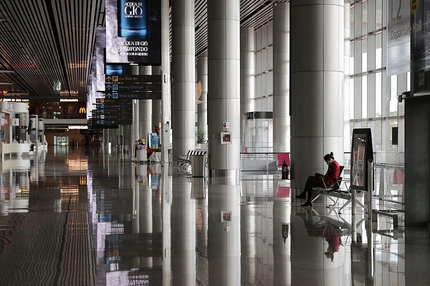 The departure hall at Changi Airport's Terminal 4 on May 12, during the circuit breaker period to stop the spread of the coronavirus. With most planes still grounded, Singapore's aviation sector has been hard hit, with not only airlines affected but