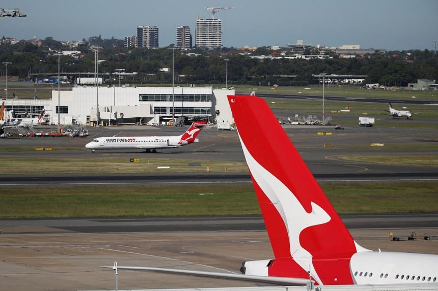 Qantas swung to a net loss of A$1.96 billion (S$1.93 billion) from a profit of A$840 million a year earlier.