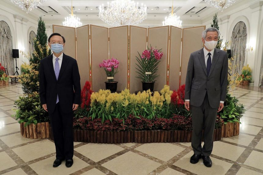 Mr Yang Jiechi (left) called on PM Lee Hsien Loong at the Istana on Aug 20, 2020.