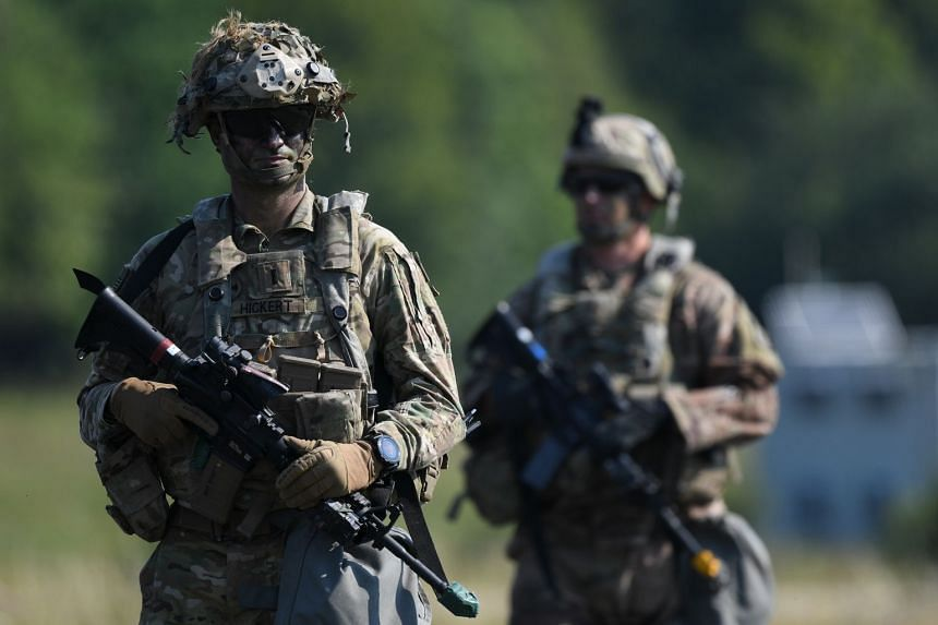 US soldiers patrol at the US Army's Joint Multinational Readiness Centre in Hohenfels, Germany.