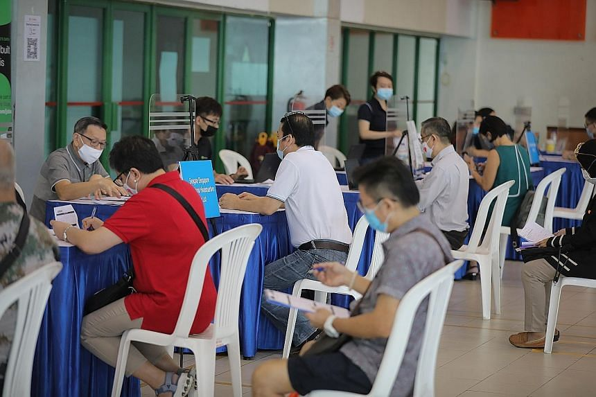 Job seekers at a job fair at Chong Pang Community Club yesterday, which drew some 160 Singaporeans. The fair offered job seekers career advice and on-the-spot interviews with potential employers.