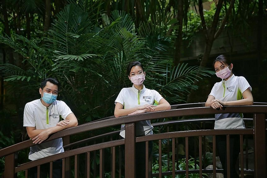 Former SIA cabin crew members (from left) Tristan Yap, Regina Yeoh and Sandra Goh found meaning in their work as temporary care ambassadors and decided to quit their airline jobs to become patient care officers at Khoo Teck Puat Hospital. Mr Yap said