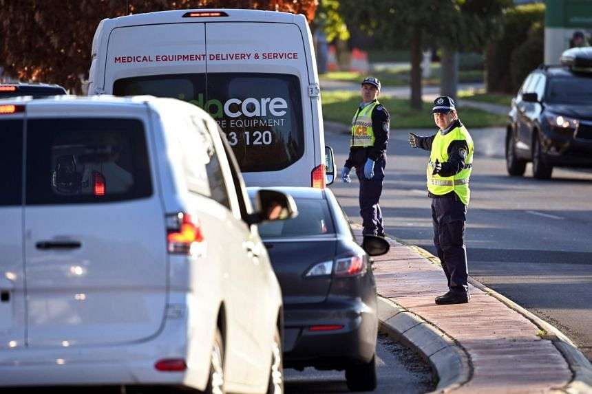 Police in the border city of Albury check cars crossing the state border from Victoria, on July 8, 2020.