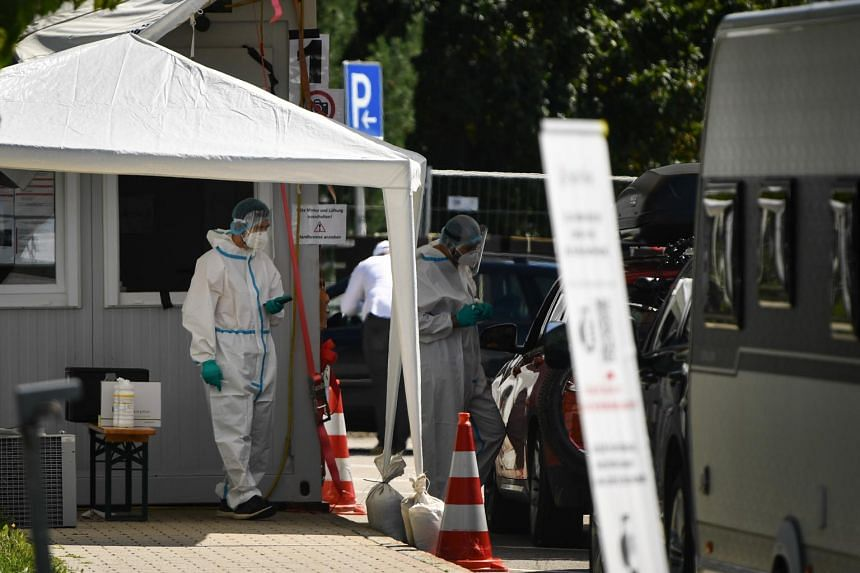 Health workers collecting test samples at a Covid-19 test station in Hochfelln, Germany, on Aug 19, 2020.