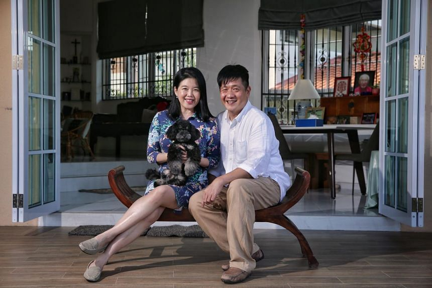 Ms Reene Ho-Phang and her husband Peter Phang with their adopted black poodle Charcoal at home on Aug 19, 2020.
