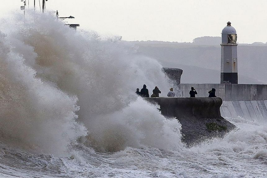 Huge waves crashing against the sea wall at Porthcawl, south Wales, yesterday as Storm Ellen brought high winds to Britain and Ireland. Weather warnings were in place across the country, with flood alerts for coastal counties. Transport services were