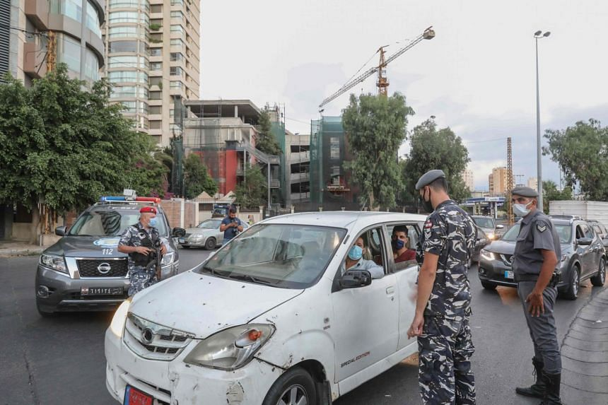 Lebanese security at a checkpoint on an avenue in the capital Beirut to verify the compliance with a reinstated lockdown on Aug 21, 2020.