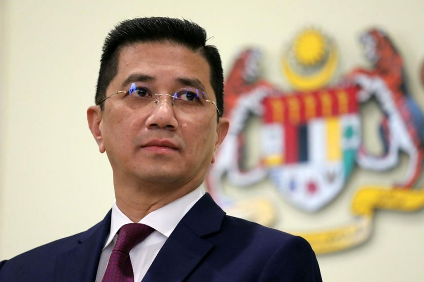 Senior minister Azmin Ali (above) and 10 other MPs will be joining Prime Minister Muhyiddin Yassin's political party.
