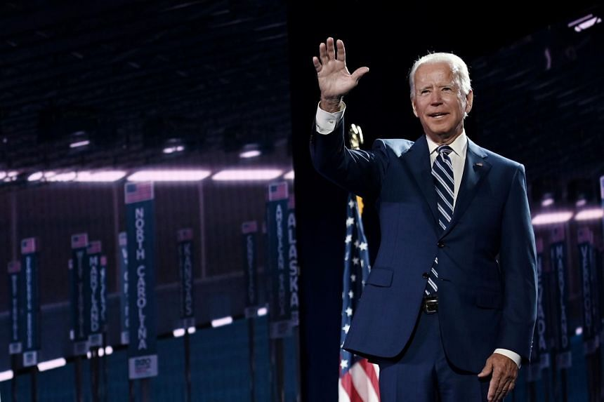 Joe Biden waves on stage at the Chase Center in Wilmington, Delaware, on Aug 19, 2020.