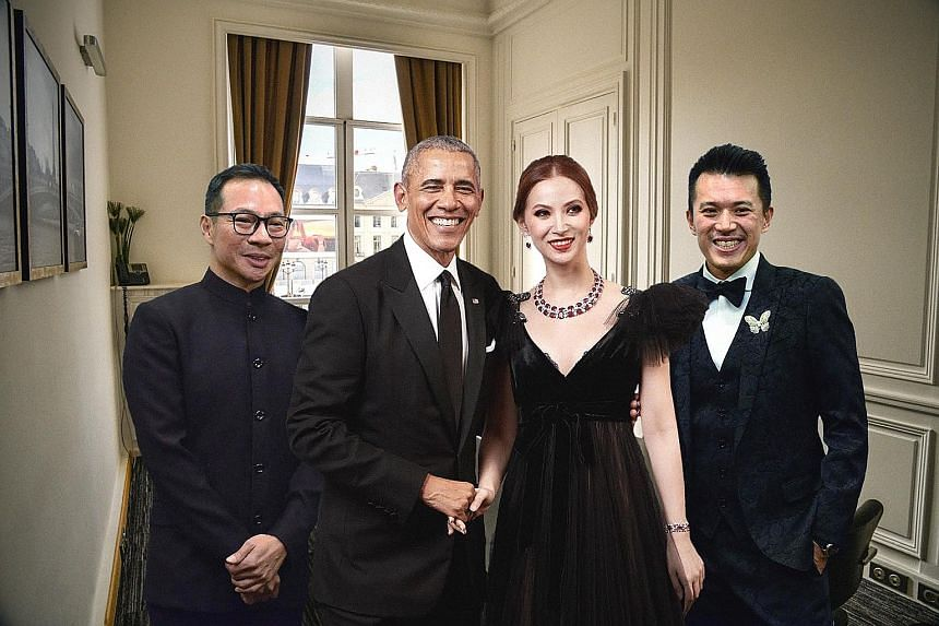 Above: A publicity picture distributed by Bellagraph Nova Group that purports to show owners Terence Loh (from left), Evangeline Shen and Nelson Loh meeting former United States president Barack Obama at a private meeting in Paris. Right: In reality,