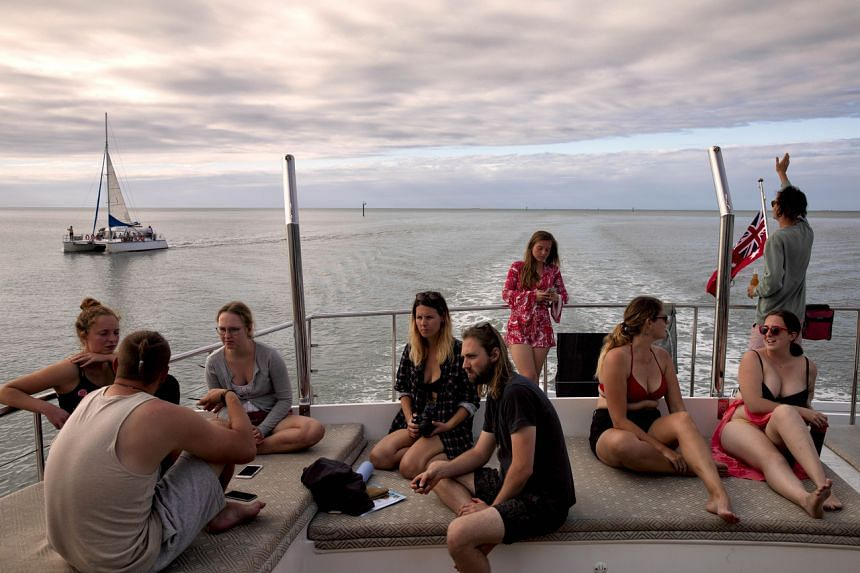 In Cairns, visitors who usually cram the jetty every morning have dwindled from the thousands to a few hundred.
