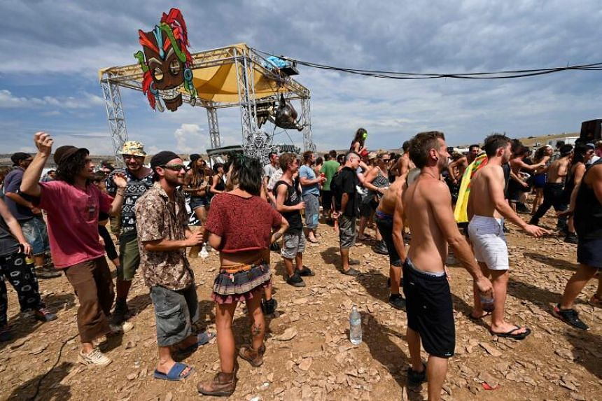 People are seen at a rave in Causse Mejean, in France's Lozere region, on Aug 10, 2020.