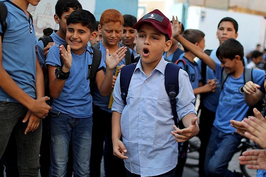 Abdel Rahman al-Shantti, 11, performing at his school in Gaza City on Aug 16. His video received over one million views and praise from famous rappers.