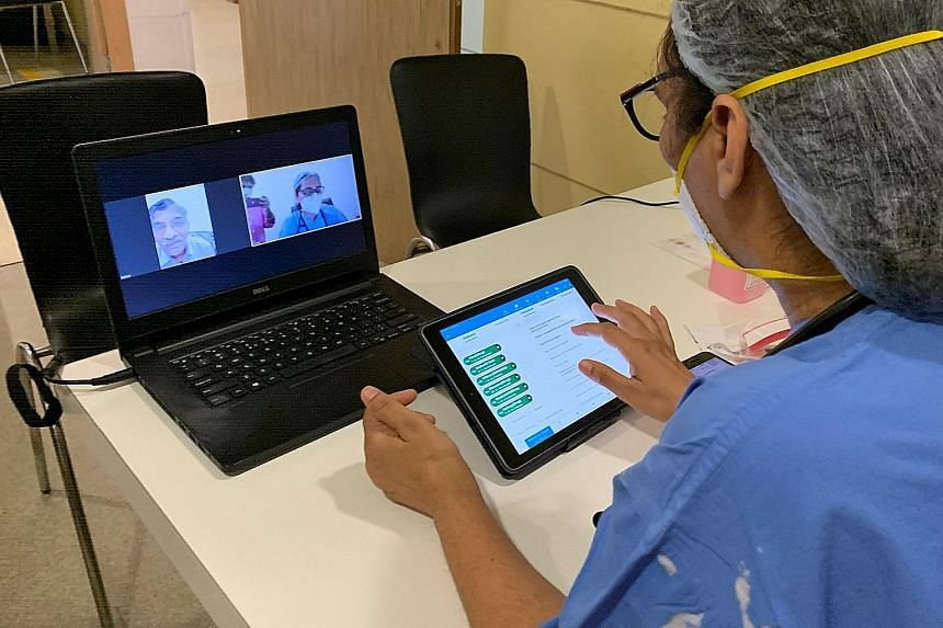 A doctor talking to a patient via video call, at a hospital in Gurugram, India, on May 22. The Covid-19 pandemic has forced many Indians to experience the fragility of the country's healthcare system.