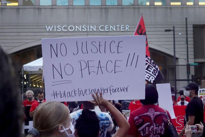 People protesting outside the Wisconsin Center, on Aug 20, 2020, in Milwaukee, Wisconsin.