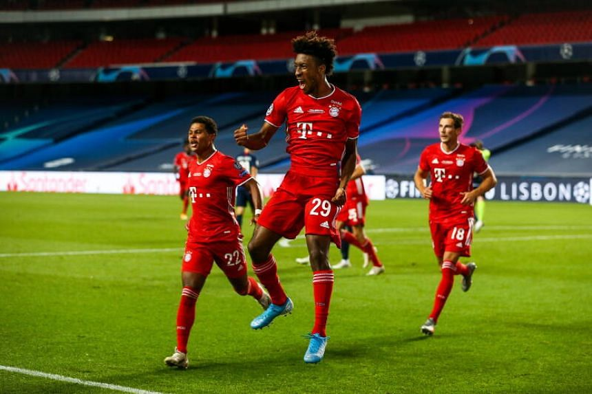 Bayern Munich's Kingsley Coman (centre) celebrates after scoring the opening goal against Paris St Germain.