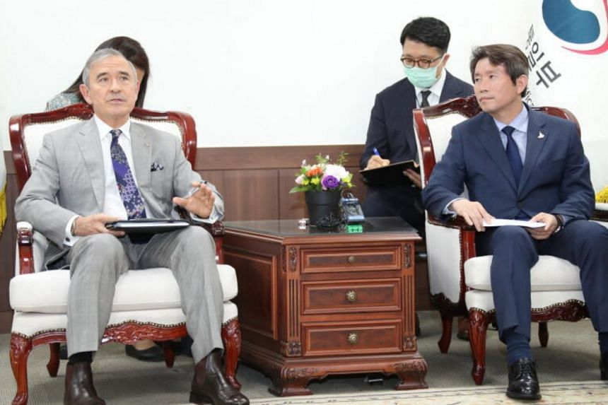 Unification Minister Lee In-young, South Korea's point man for inter-Korean relations, holds talks with US Ambassador to South Korea Harry Harris at Mr Lee's office in Seoul on 18 August 2020.