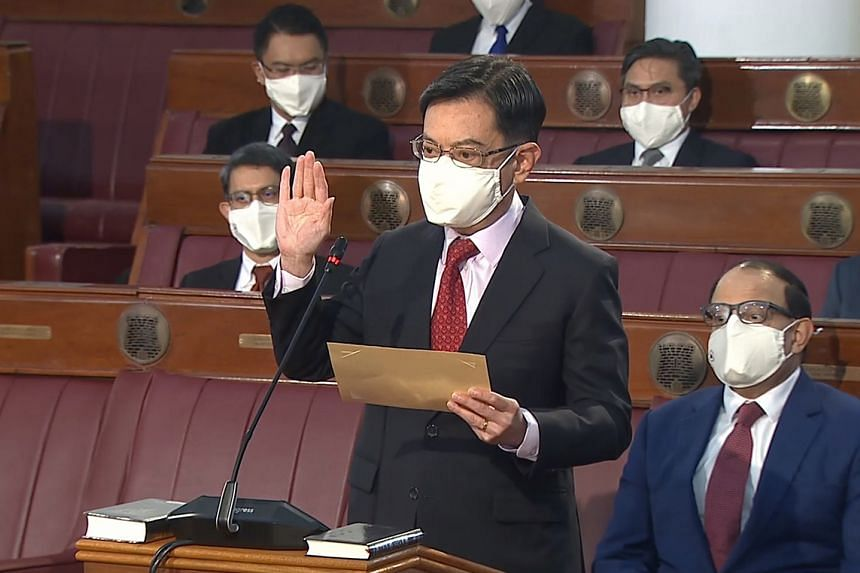 Deputy Prime Minister Heng Swee Keat taking his oath at the opening of the 14th Parliament.