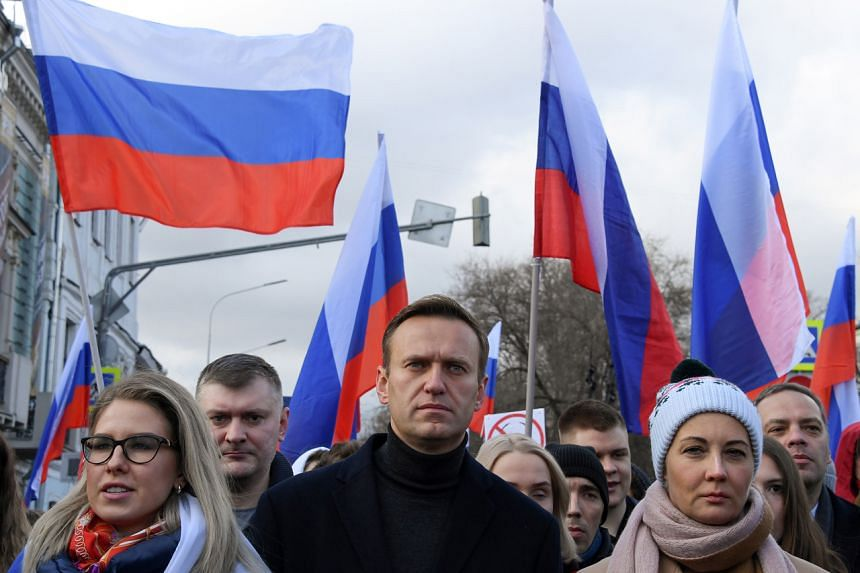 Russian opposition leader Alexei Navalny (centre) during a demonstration in downtown Moscow on Feb 29, 2020.