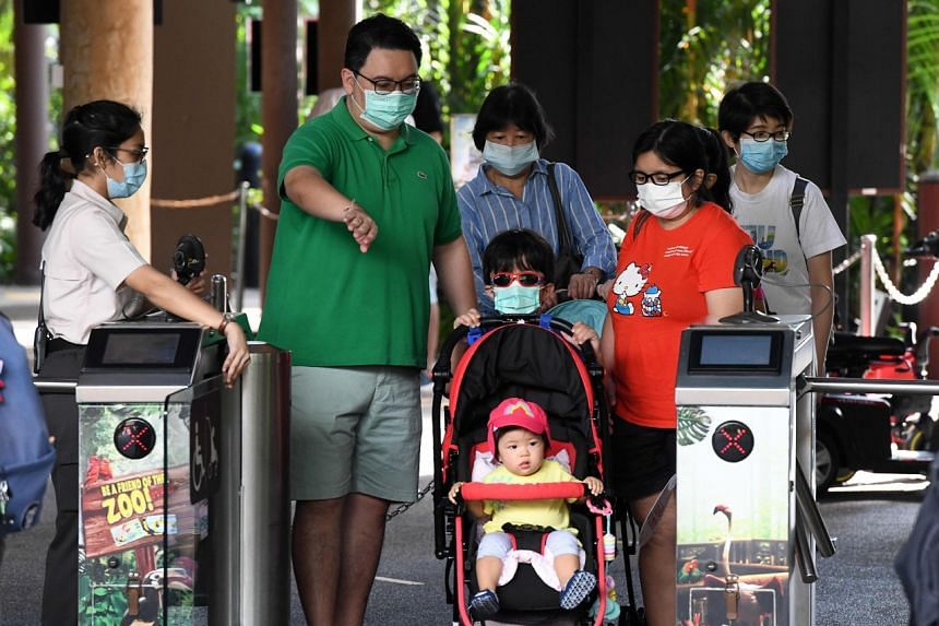A family enters Jurong Bird Park on July 24, 2020.