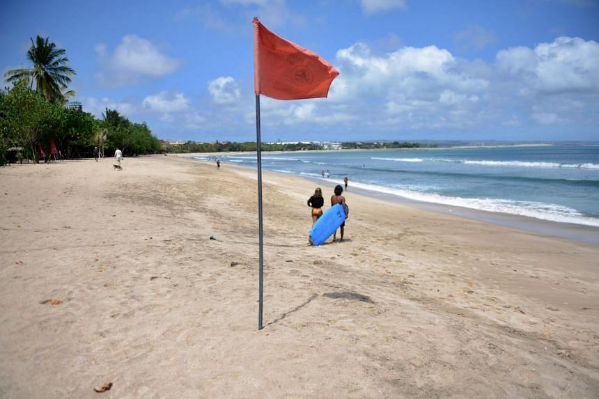 People visiting Kuta beach on the Indonesian resort island of Bali, on Aug 15, 2020.