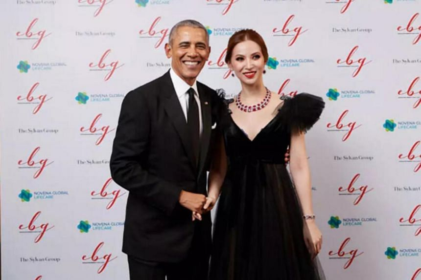 Ms Evangeline Shen pictured here with former US president Barack Obama at a charity gala event in Singapore in December 2019.